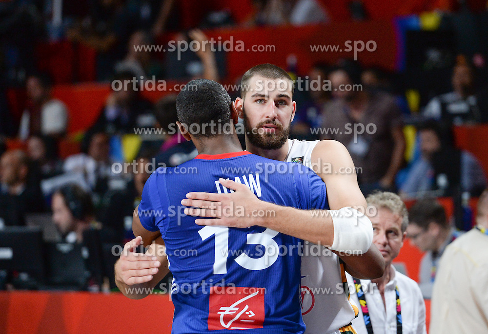 Boris Diaw of France and Jonas Valanciunas of Lithuania after the 2014 FIBA World Basketball Championship Third Place match between France and Lithuania at the Palacio de los Deportes, on September 13, 2014 in Madrid, Spain. Photo by Tom Luksys  / Sportida.com <br /> ONLY FOR Slovenia, France