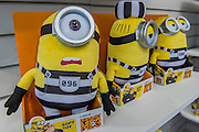 New Minions prison characters from Despicable Me 3 on the Posh Paws stand - The London Toy Fair opens at Olympia exhibition centre. Organised by the British Toy and Hobby Association it is the only dedicated toy, game and hobby trade exhibition in the UK. It runs for three days, with more than 240 exhibiting companies ranging from the large internationals to the new start up companies.