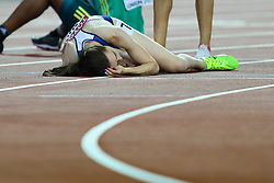 London, 2017 August 07. Laura Muir, Great Britain, lies exhausted on the track after missing out on bronze in the women's 1,500m final on day four of the IAAF London 2017 world Championships at the London Stadium. © Paul Davey.