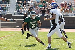 15 September 2007:  Chad Olson set his sights on a passing Vince Palmer. The Titans stood toe to toe with the 25th ranked Lions through the first half but ended the game on the losing end of a 25-15 score at Wilder Field on the campus of Illinois Wesleyan University in Bloomington Illinois.