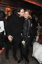 ADAM WAYMOUTH and ELIZABETH VON GUTTMAN at a party to celebrate the opening of the Muzungu Sisters Pop Up Store at Momo - an ethically sourced fashion brand  held at Momo, 25 Heddon Street, London on 27th October 2011.
