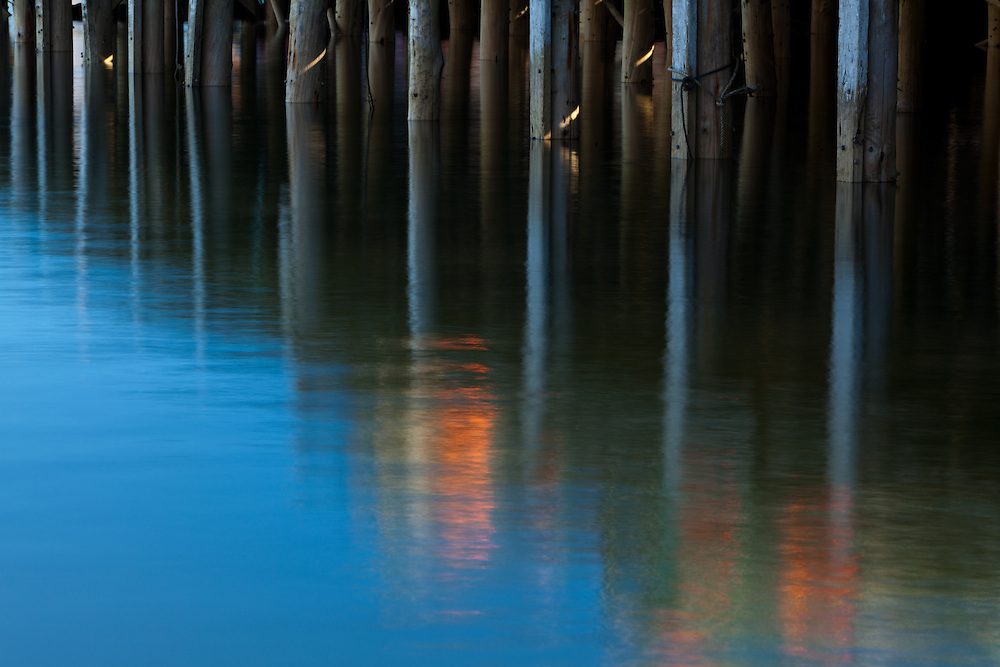 a colorful reflection of a fishing pier in Maine creates an almost painterly abstract
