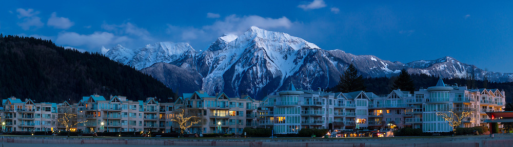 Late evening light on the Mount Cheam Range (from L to R: Stewart, Baby Munday, Knight, Lady and Cheam Peaks and Mount Archibald) and the beach front condominiums at Harrison Hot Springs, British Columbia, Canada