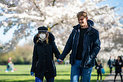© Licensed to London News Pictures. 22/03/2020. LONDON, UK. People enjoy mothers day whilst practicing social distancing in Battersea Park, London on 22 March 2020. The government had advised people to practice social distancing measures that help reduce the transmission of Coronavirus (COVID-19). Photo credit: Luke Dray/LNP