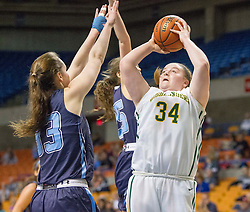 Huntington forward Ericka Budd (34) shoots down low over Spring Valley forward Madison Morris (33) during a first round game at the Charleston Civic Center.