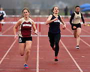 Lauren Bamford of Pittsford Mendon leads Meaghan Schwartz of Gates-Chili in the 400-meter hurdles at the His and Her track and field invitational at Penfield High School on Saturday, April 26, 2014.