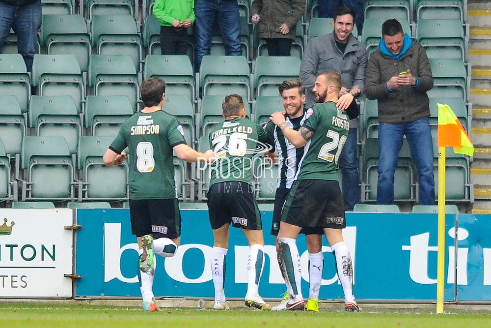 Plymouth Argyle's Graham Carey celebrates his goal with  Joshua Simpson, Oscar Threlkeld and Jordon Forster during the Sky Bet League 2 match between Plymouth Argyle and Notts County at Home Park, Plymouth, England on 27 February 2016. Photo by Graham Hunt.