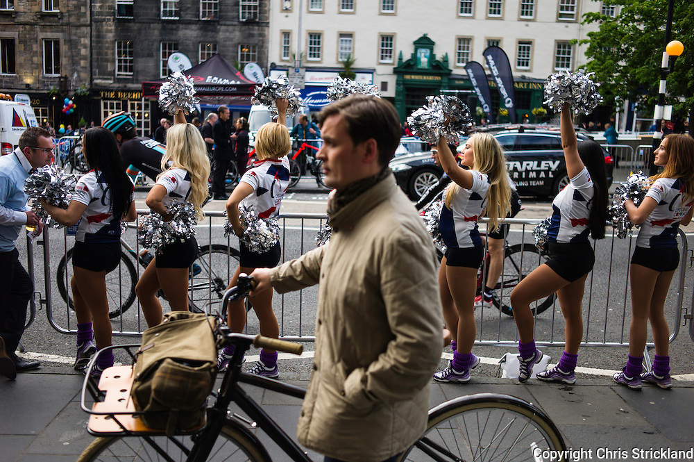 Edinburgh, UK, 29th May 2014. Cheerleaders encourage riders during the mens race through Edinburgh's Grassmarket in round six of the Pearl Izumi Tour Series. The aim for teams is to place three of their riders as high up the finishing order as possible and record the lowest cumulative points. The tour consists of ten venues across the UK each year.