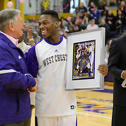 Staff photos by Tom Kelly IV<br /> West Chester Athletic Director Edward Matejkovic (left) shakes hands with Shannon Givens (12) during senior night festivities before the Shippensburg at West Chester University men's basketball game on Saturday, February 15, 2014.