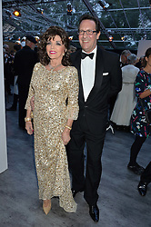 DAME JOAN COLLINS and PERCY GIBSON at British Vogue's Centenary Gala Dinner in Kensington Gardens, London on 23rd May 2016.