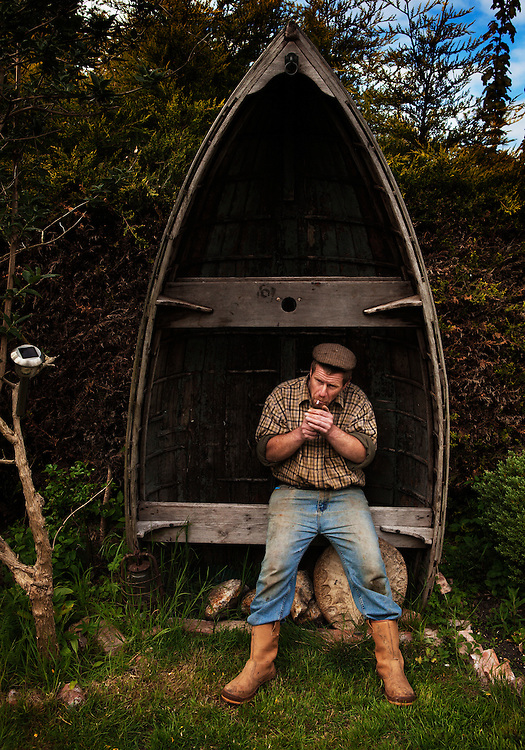 Nicky King, fisherman, in his garden, Wells-next-the-Sea, North Norfolk, U.K.,<br /> <br /> &quot;Fishing, you've got to be a bloody minded individual to do it. You've got to have a sense of humour or a sense of the ridiculous!&quot;<br /> <br /> Nicky King.