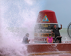 Key West resident Pedro Lara takes selfie in front of the Southernmost Point in the USA monument as waves from Hurrican Irma crash over the wall on Saturday, September 9, 2017. Some residents refused to evacuate as Hurricane Iram approaches the Florida Keys. Photo by Charles Trainor Jr./Miami Herald/TNS/ABACAPRESS.COM