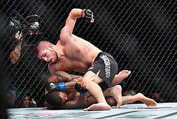 "Nov 12, 2016 - New York, New York, U.S. - Khabib Nurmagomedov ""The Eagle"" (red gloves) vs. Michael ""The Menace"" Johnson (blue gloves) during UFC 205 at Madison Square Garden. (Credit Image: © Jason Silva via ZUMA Wire)"