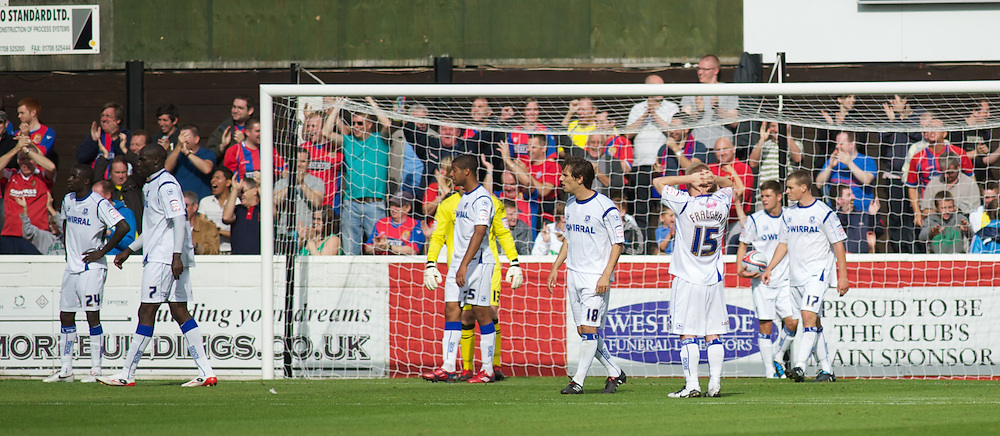 DAGENHAM, ENGLAND - Saturday, August 28, 2010: Tranmere Rovers' players once again look dejected after they concede a second goal to make it 2-0 against Dagenham & Redbridge during the Football League One match at Victoria Road. (Photo by Gareth Davies/Propaganda)