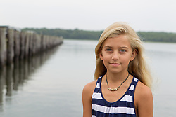 portrait of a little girl with blonde hair at the bay in East Hampton, NY
