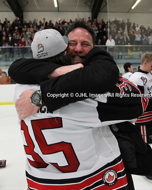 GEORGETOWN, ON  - APR 26,  2017: Ontario Junior Hockey League, Championship Series. Georgetown Raiders vs the Trenton Golden Hawks in Game 7 of the Buckland Cup Final. The post game celebration of the 2017 Buckland Cup Championship between Coach Walters and goaltender Nicholas Latinovich #35.<br /> (Photo by Tim Bates / OJHL Images)