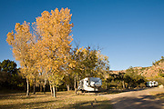Cottonwood trees add color to a frequented camp and RV site in Palo Duro Canyon State Park.