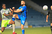 Aaron Wilbraham fouls Isaiah Osbourne during the EFL Sky Bet League 1 match between Rochdale and Walsall at Spotland, Rochdale, England on 25 August 2018.