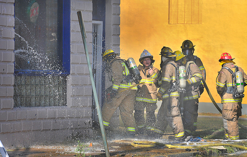 Deputy Fire chief Klapat sends a group of firefighters into the fire at Goodfellas on N Pennsylvania Ave in Wilkes-Barre. 091714 Aimee Dilger | The Times Leader