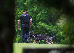 © London News Pictures. 24/05/2015. London, UK. Police with dogs search Oxford University Parks in Oxford City centre, where they are currently searching for 21 year old Jed Allen who is wanted in connection with the deaths of a man, a woman and a girl, found at a property in Didcot,  Oxfordshire.. Photo credit: Ben Cawthra/LNP