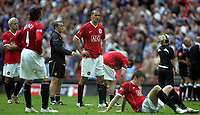 Photo: Paul Thomas.<br /> Chelsea v Manchester United. The FA Cup Final. 19/05/2007.<br /> <br /> Rio Ferdinand and his Utd team-mates show their dejection.