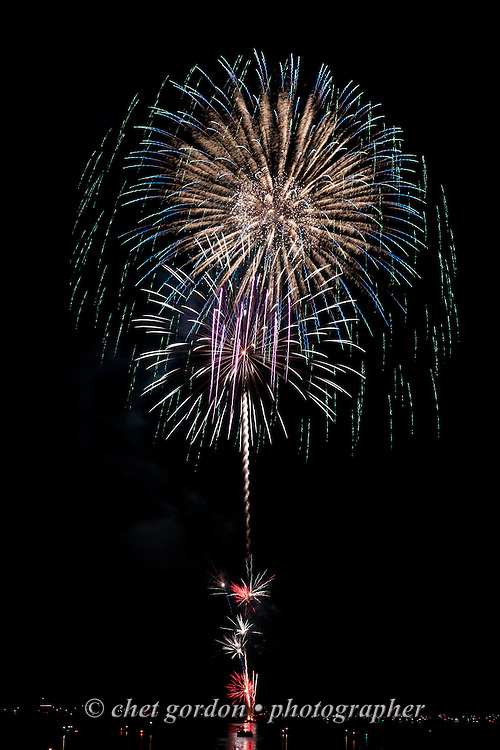 GREENWOOD LAKE, NY.  Fireworks explode over Greenwood Lake, NY on Sunday evening, July 5, 2015.  © Chet Gordon/THE IMAGE WORKS