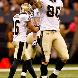 Oct 24, 2010; New Orleans, LA, USA; New Orleans Saints tight end Jimmy Graham (80) signals first down following a catch during the first half against the Cleveland Browns at the Louisiana Superdome. Mandatory Credit: Derick E. Hingle