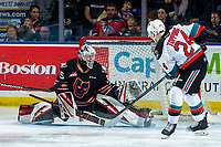 KELOWNA, BC - FEBRUARY 17: Brayden Peters #35 of the Calgary Hitmen makes a second period save on a shot by Kyle Topping #24 of the Kelowna Rockets at Prospera Place on February 17, 2020 in Kelowna, Canada. (Photo by Marissa Baecker/Shoot the Breeze)