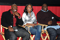 "Morris Chestnut, Gabrielle Union and Faizon Love answer questions after a screening of the movie, ""A Perfect Holiday"" in Washington, DC on December 4, 2007"