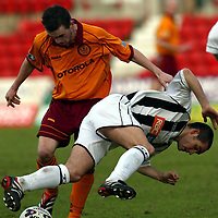 Dunfermline v Motherwell   19.01.02<br />James McFadden brings down Gary Mason<br /><br />Pic by Graeme Hart<br />Copyright Perthshire Picture Agency<br />Tel: 01738 623350 / 07990 594431
