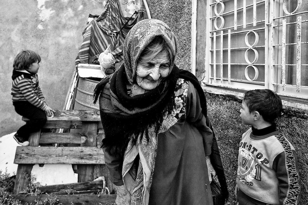 An elderly woman and her grandchildren in the village of Nabi Saleh. Mar. 25, 2011. West Bank, Palestine.