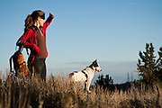 Natalie Rockwell and her dog Lance take in the sunset over Lake Tahoe from the Mt. Rose summit trail.