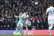 Leeds United defender Liam Cooper (6) and Queens Park Rangers forward Jordan Hugill (9) in action during the EFL Sky Bet Championship match between Leeds United and Queens Park Rangers at Elland Road, Leeds, England on 2 November 2019.