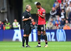 referee jon moss talks with Marcus Rashford of Manchester United  - Mandatory by-line: Alex James/JMP - 19/08/2017 - FOOTBALL - Liberty Stadium - Swansea, England - Swansea City v Manchester United - Premier League