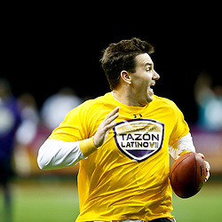 Jan 31, 2013; New Orleans, LA, USA; AFC squad Jake Delhomme runs for a touchdown during the Tazon Latino VII flag football game at Clinic Field  inside the Ernest Morial Convention center against the NFC squad. Super Bowl XLVII will take place between the San Francisco 49ers and the Baltimore Ravens on February 3, 2013 at the Mercedes-Benz Superdome.  Mandatory Credit: Derick E. Hingle-USA TODAY Sports