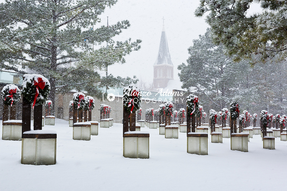 Snow falls on the Field of Empty Chairs at the Oklahoma City National Memorial in downtown Oklahoma City on Saturday, Dec. 27, 2014. (Photo copyright © 2014 Alonzo J. Adams)