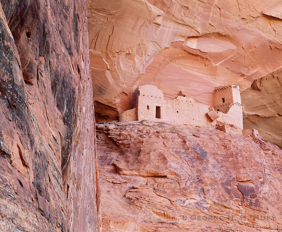 0100-1020 ~ Copyright: George H. H. Huey ~ Tower ruin at Mummy Cave, Canyon del Muerto. Anasazi culture site, occupied A.D. 1000's-12000's. Canyon de Chelly National Monument, Arizona.