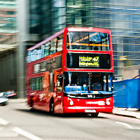 Intentionally motion blurred image of a double decker bus in London.