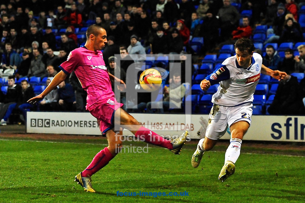 Picture by Ian Wadkins/Focus Images Ltd +44 7877 568959<br /> 20/12/2013<br /> Liam Ridehalgh of Tranmere Rovers gets the cross in during the Sky Bet League 1 match at Prenton Park, Birkenhead.