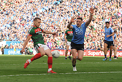 Mayo&rsquo;s Andy Moran gets his shot away despite the attention of Dublin&rsquo;s Philly McMahon at the All Ireland Football Final<br /> Pic Conor McKeown