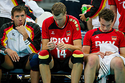 12.09.2011, O2 Arena, Prag, CZE, Europameisterschaft Volleyball Maenner, Vorrunde D, Deutschland (GER) vs Bulgarien (BUL), im Bild Bjoern/Björn Andrae (#5 GER / Kemerovo RUS), Robert Kromm (#14 GER / Verona ITA), Denis Kaliberda (#6 GER / Haching GER) nach dem EM-Aus // during the 2011 CEV European Championship, Germany vs Bulgaria at O2 Arena, Prague, 2011-09-12. EXPA Pictures © 2011, PhotoCredit: EXPA/ nph/  Kurth       ****** out of GER / CRO  / BEL ******