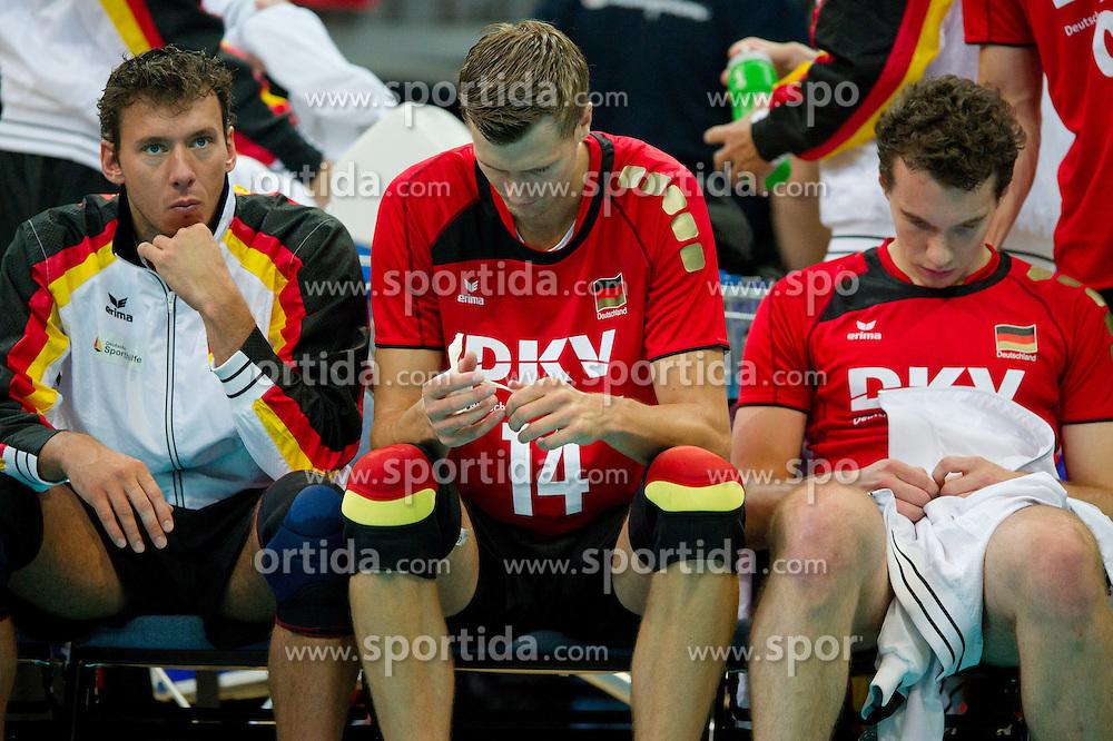 12.09.2011, O2 Arena, Prag, CZE, Europameisterschaft Volleyball Maenner, Vorrunde D, Deutschland (GER) vs Bulgarien (BUL), im Bild Bjoern/Björn Andrae (#5 GER / Kemerovo RUS), Robert Kromm (#14 GER / Verona ITA), Denis Kaliberda (#6 GER / Haching GER) nach dem EM-Aus // during the 2011 CEV European Championship, Germany vs Bulgaria at O2 Arena, Prague, 2011-09-12. EXPA Pictures © 2011, PhotoCredit: EXPA/ nph/  Kurth       ****** out of GER / CRO  / BEL ******