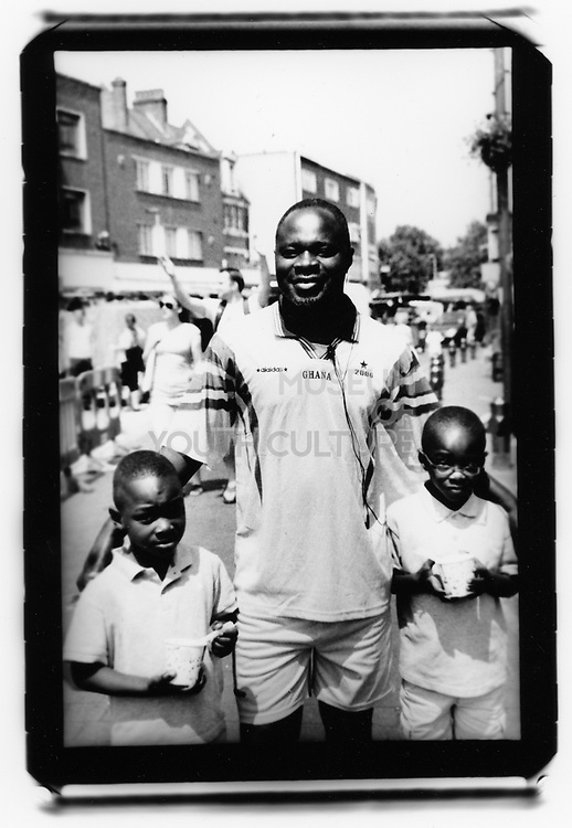 Ghanese Father with his young son, Lewisham, South London 2010