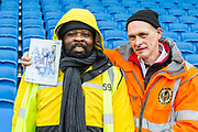 Match Day Programme along with two of the Stewards for the South Stand ahead of the Premier League match between Brighton and Hove Albion and Crystal Palace at the American Express Community Stadium, Brighton and Hove, England on 29 February 2020.