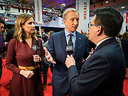 "14 JANUARY 2020 - DES MOINES, IOWA: California businessman TOM STEYER talks to reporters from CBS Television in the ""spin room"" after the CNN Democratic Presidential Debate on the campus of Drake University in Des Moines. This is the last debate before the Iowa Caucuses on Feb. 3.    PHOTO BY JACK KURTZ"