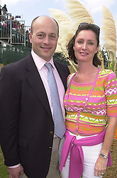 MR & MRS SHOLTO DOUGLAS-HOME at a polo match in Sussex on 23rd July 2000.OGI 58