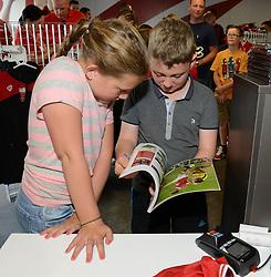 Two young Bristol City fans read the 'champions' book at the new club shop  - Mandatory byline: Dougie Allward/JMP - 07966386802 - 15/08/2015 - FOOTBALL - Ashton Gate -Bristol,England - Bristol City v Brentford - Sky Bet Championship