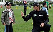 Kyle Millis gives the thumps up to a cricket fan at the National Bank's Cricket Super Camp , University oval, Dunedin, New Zealand. Thursday 2 February 2012 . Photo: Richard Hood photosport.co.nz