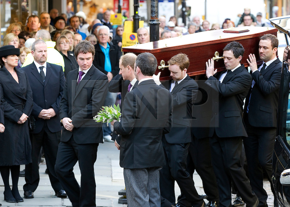 © Licensed to London News Pictures. 22/10/2011. Manchester, UK. The coffin carrying Betty Driver arrives at the church. The funeral of former Coronation Street actress Betty Driver at St Ann's Church in Manchester. The actress lived to the age of 91. Photo credit : Joel Goodman/LNP