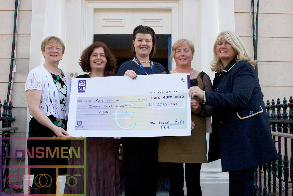 The large Folios from the property registration authority presenting a cheque to the Temple Street Hospital. Elish Moroney, Ena Campbell, Jean Lynch, Mary Celine Burke & Susan Bradley from the fundraising office.